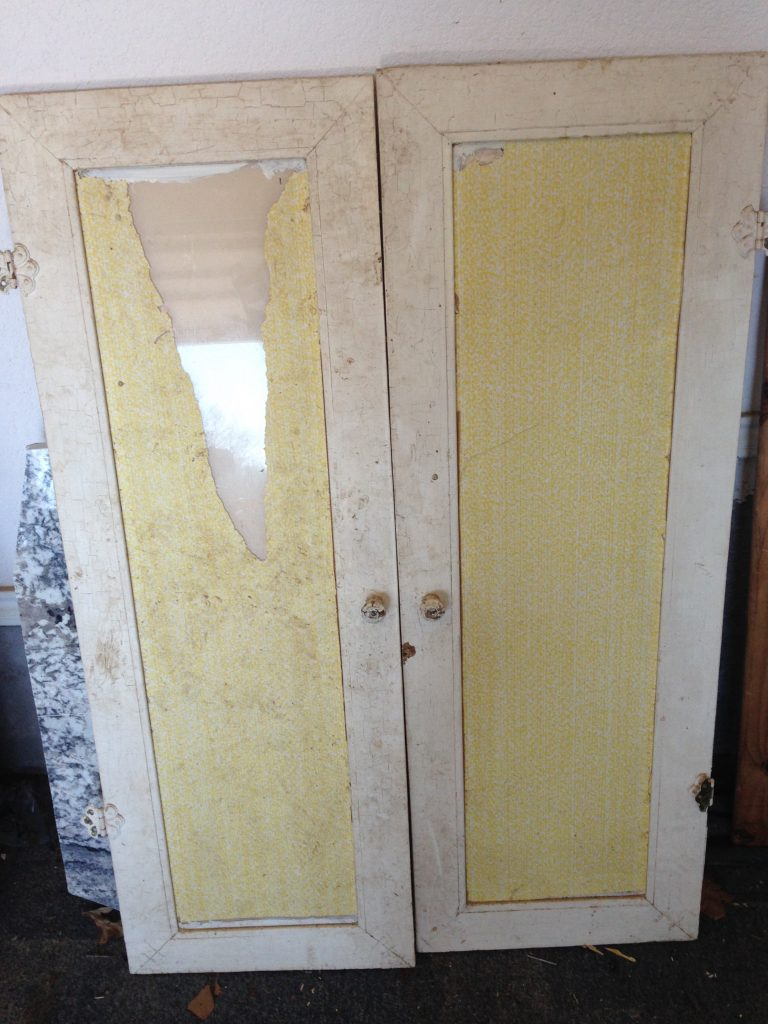 China hutch doors covered in paper