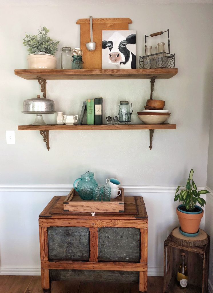 Breakfast room decor with salvaged barn wood shelves